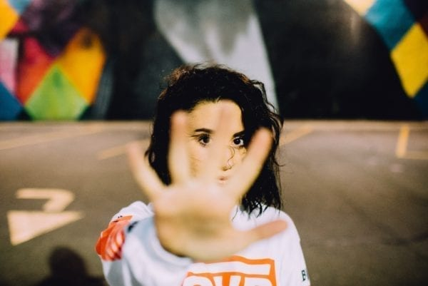 girl with hand in front of her face