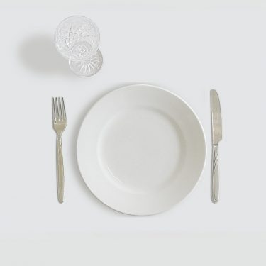 an empty plate with silverware | Is Tofu Healthy? 21 Benefits and Disadvantages - It Helps You Eat Less