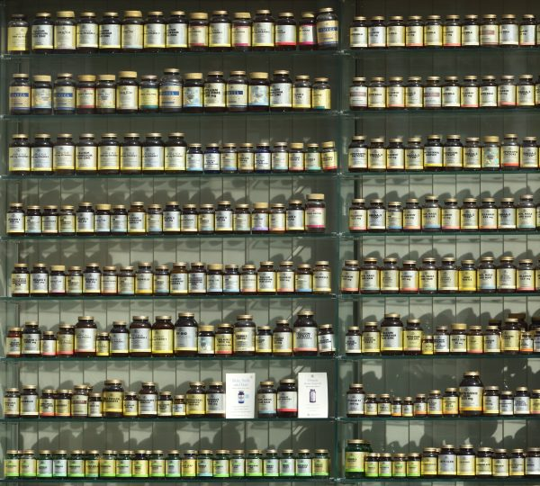 A huge wall full of medicine and vitamin supplements | Macronutrients vs. Micronutrients: The Complete Guide