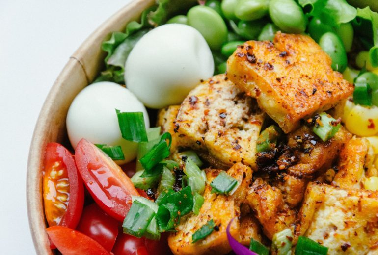A bowl of tofu, eggs, tomatoes, edamame, lettuce, and green onions   The Best Vitamin B12 Foods for Vegetarians and Vegans