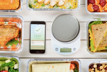 A table of food with a food scale and macro tracking app | Best Macronutrient Ratio For Weight Loss: How To Calculate | Plant Based Scotty